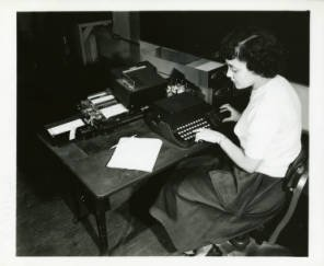 An NBS employee operating the SEAC keyboard.